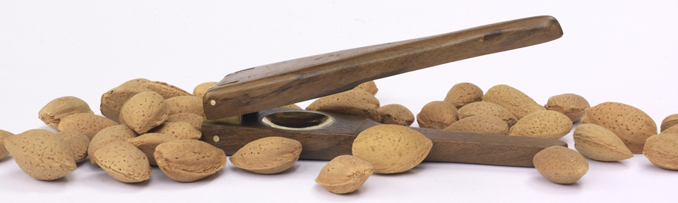 """SagaMagazine - """"At last... nutcrackers that are user-friendly, touchy feely (made of wood), fit in the kitchen drawer and work. I'm not a fan of those big heavy metal ones... I usually end up hitting the nuts with them... so I'm thrilled with this teak and brass design"""""""